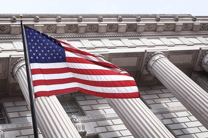 USA flag and commerce building