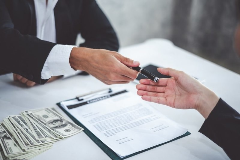 Signing Business Loan Contract | Spring Law
